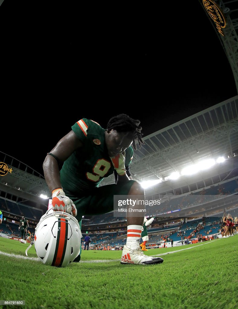 Chad Thomas #9 of the Miami Hurricanes takes a knee after a game against the Syracuse Orange at Sun Life Stadium on October 21, 2017 in Miami Gardens, Florida.