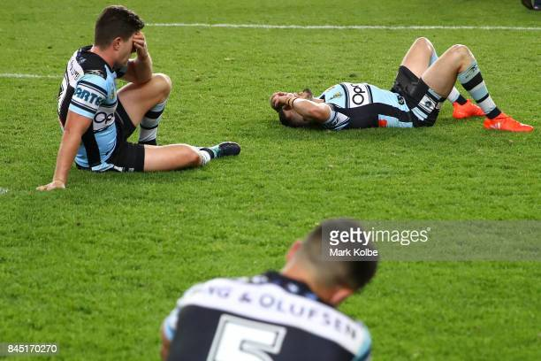 Chad Townsend Jack Bird and Gerard Beale of the Sharks look dejected after defeat during the NRL Elimination Final match between the Cronulla Sharks...