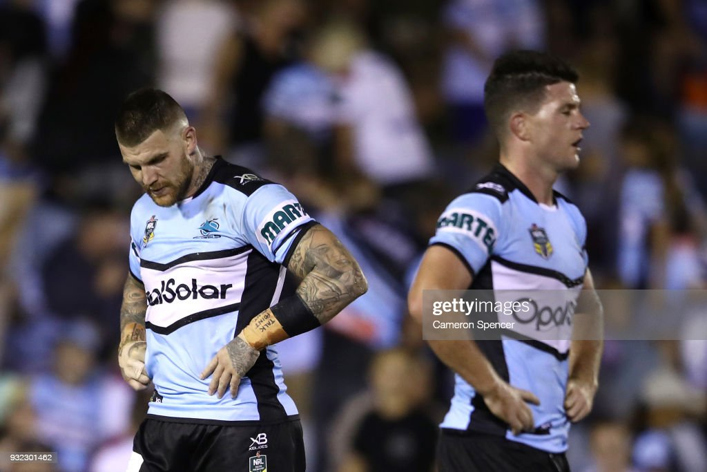 Chad Townsend of the Sharks and Josh Dugan of the Sharks look dejected after losing the round two NRL match between the Cronulla Sharks and the St George Illawarra Dragons at Southern Cross Group Stadium on March 15, 2018 in Sydney, Australia.