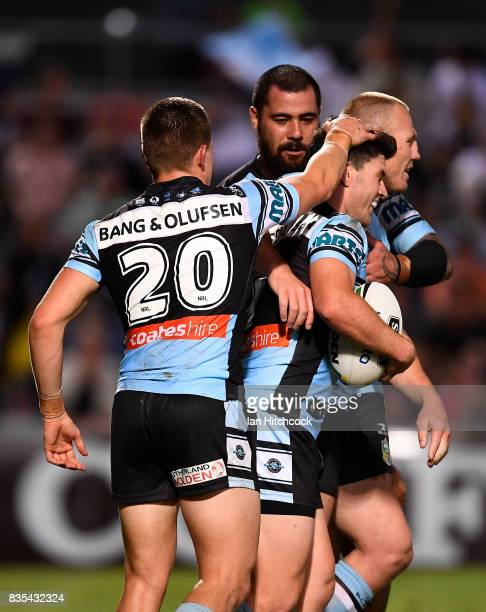Chad Townsend of the Sharks celebrates after scoring a try during the round 24 NRL match between the North Queensland Cowboys and the Cronulla Sharks...