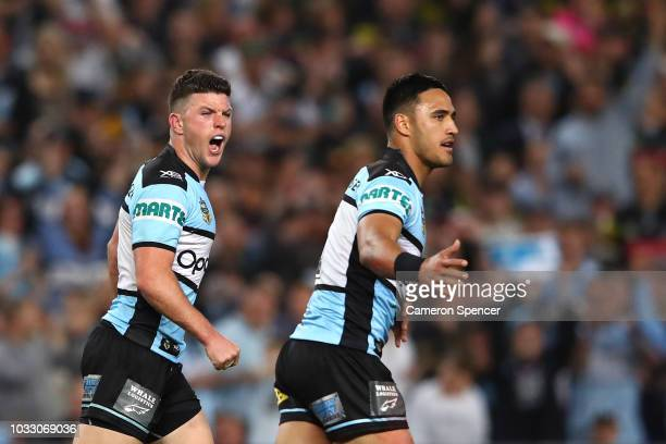 Chad Townsend of the Sharks celebrates kicking a field goal with team mate Valentine Holmes during the NRL Semi Final match between the Cronulla...