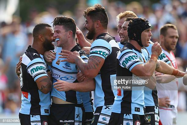 Chad Townsend of the Sharks celebrates with his team mates after scoring a try during the round two NRL match between the Cronulla Sharks and the St...