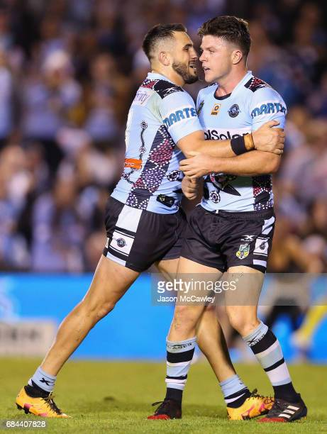 Chad Townsend of the Sharks is congratulated by Jack Bird after scoring a try during the round 11 NRL match between the Cronulla Sharks and the North...