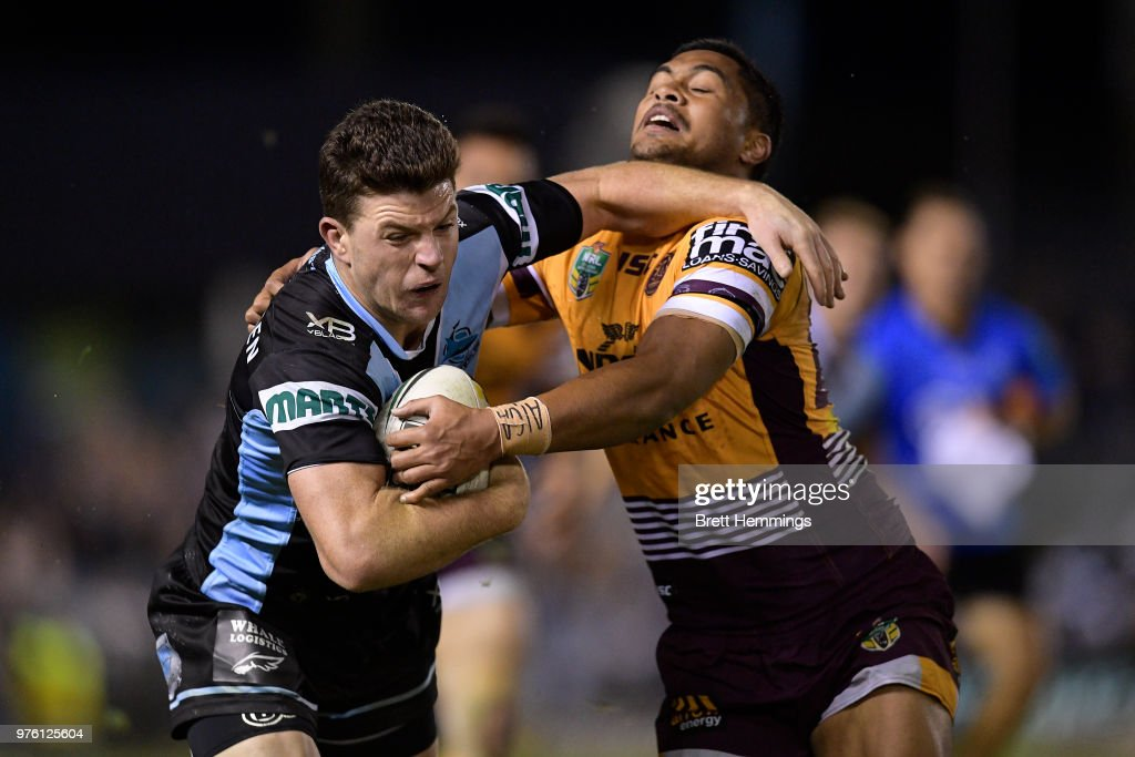 Chad Townsend of the Sharks is tackled during the round 15 NRL match between the Cronulla Sharks and the Brisbane Broncos at Southern Cross Group Stadium on June 16, 2018 in Sydney, Australia.