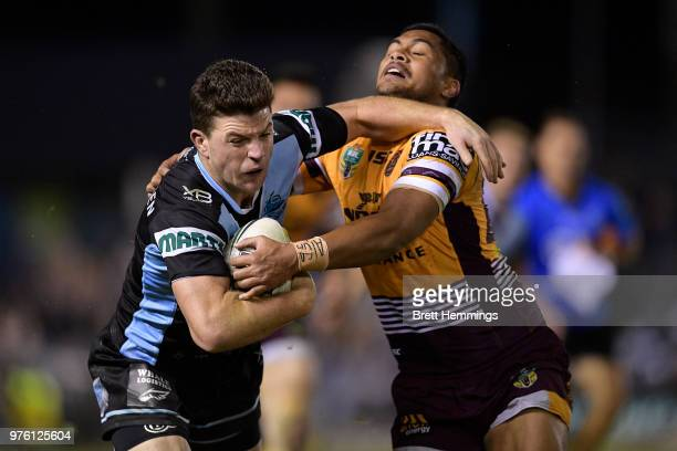 Chad Townsend of the Sharks is tackled during the round 15 NRL match between the Cronulla Sharks and the Brisbane Broncos at Southern Cross Group...