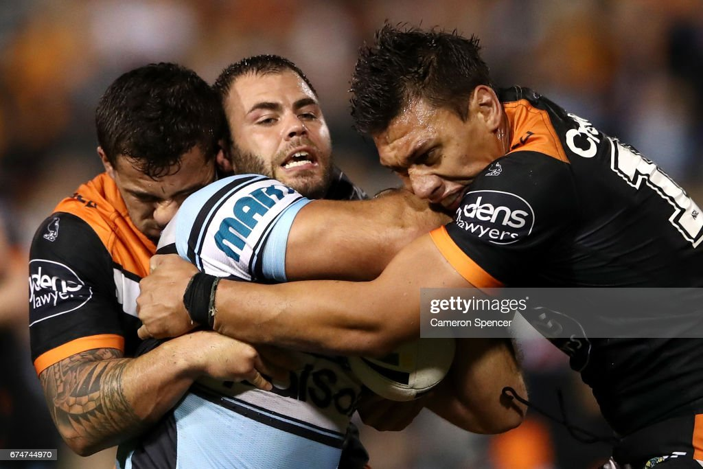 Chad Townsend of the Sharks is tackled during the round nine NRL match between the Wests Tigers and the Cronulla Sharks at Leichhardt Oval on April 29, 2017 in Sydney, Australia.