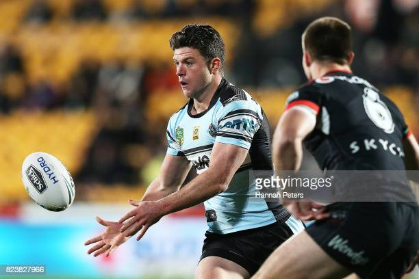 Chad Townsend of the Sharks passes the ball out during the round 21 NRL match between the New Zealand Warriors and the Cronulla Sharks at Mt Smart...