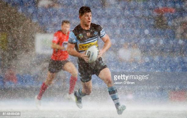 Chad Townsend of the sharks runs with the ball during the round 19 NRL match between the Gold Coast Titans and the Cronulla Sharks at Cbus Super...