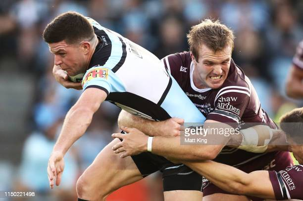Chad Townsend of the Sharks takes on the defence during the round 10 NRL match between the Cronulla Sharks and the Manly Sea Eagles at Shark Park on...