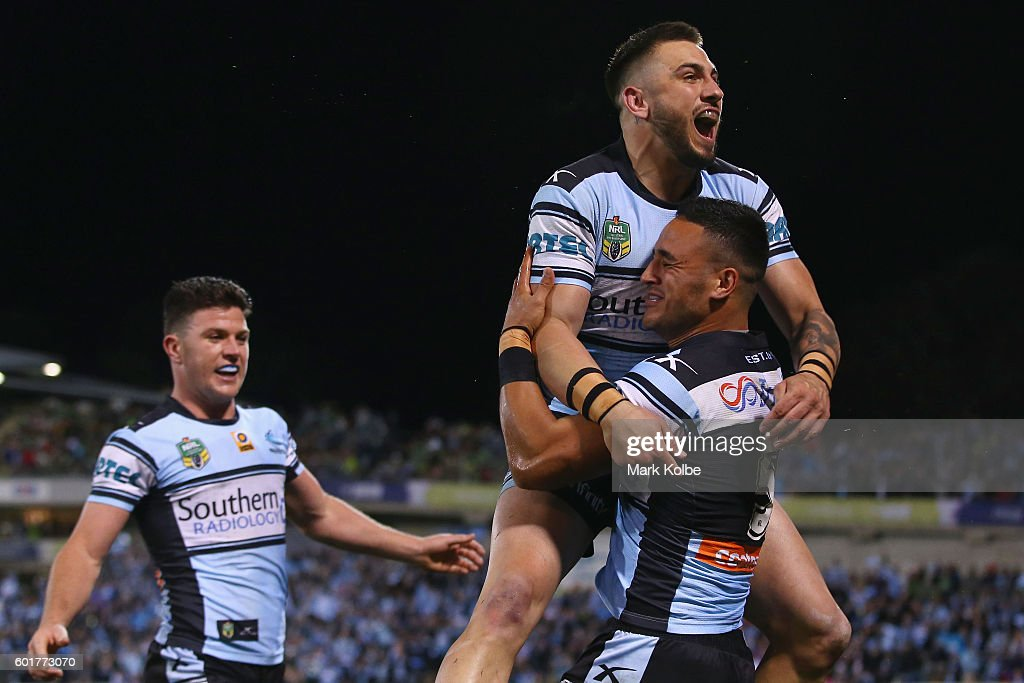 Chad Townsend of the Sharks watches on as Jack Bird and Valentine Holmes of the Sharks celebrate Holmes scoring a try during the NRL Qualifying Final match between the Canberra Raiders and the Cronulla Sharks at GIO Stadium on September 10, 2016 in Canberra, Australia.