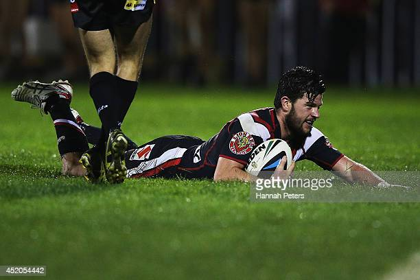 Chad Townsend of the Warriors dives over to score a try during the round 18 NRL match between the New Zealand Warriors and the Parramatta Eels at Mt...