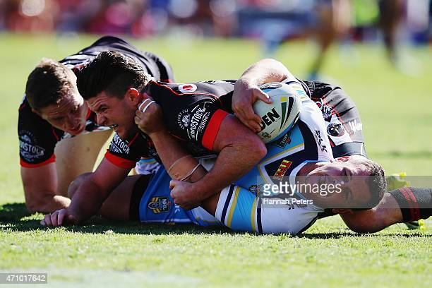 Chad Townsend of the Warriors tackles Greg Bird of the Titans during the round eight NRL match between the New Zealand Warriors and the Gold Coast...