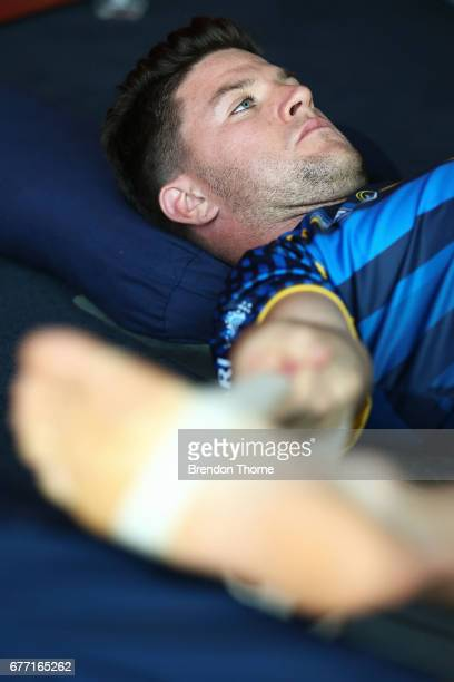 Chad Townsend stretches as part of a yoga class during a City Origin media opportunity at Andrew 'Boy' Charlton Pool on May 3 2017 in Sydney Australia