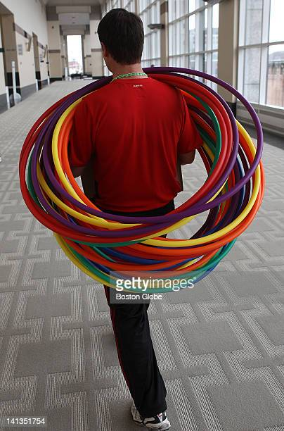 Chad Triolet of Virginia a 2011 National Teacher of the Year carries hulahoops for a class at the American Alliance for Health Physical Education...