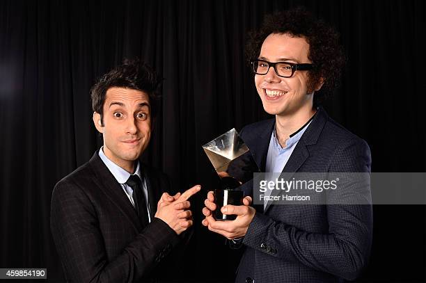 Chad Vaccarino and Ian Axel from A Great Big World pose for a portrait with the Best New Music Group award at Logo TV's 2014 NewNowNext Awards at the...
