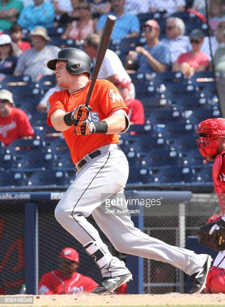 Chad Wallach of the Miami Marlins hits the ball against the Washington Nationals during a spring training game at The Ballpark of the Palm Beaches on...