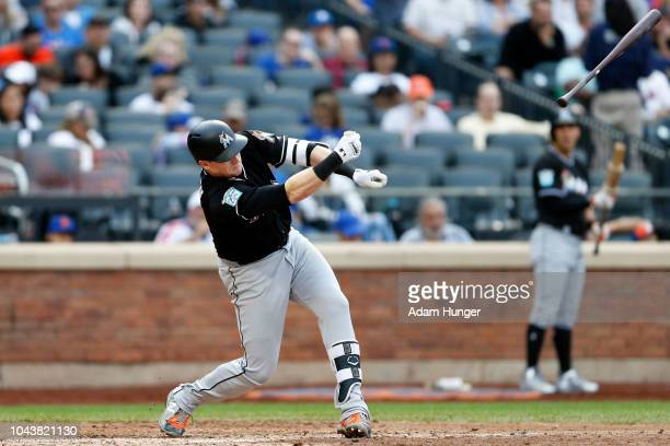 Chad Wallach of the Miami Marlins loses the grip on his bat during the eighth inning against the New York Mets at Citi Field on September 30 2018 in...
