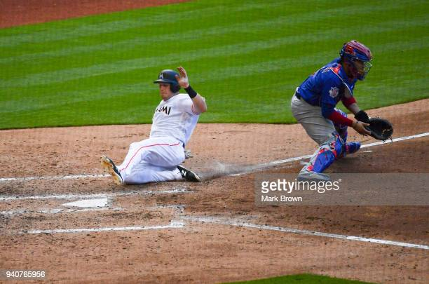 Chad Wallach of the Miami Marlins scores in the fifth inning against the Chicago Cubs at Marlins Park on April 1 2018 in Miami Florida