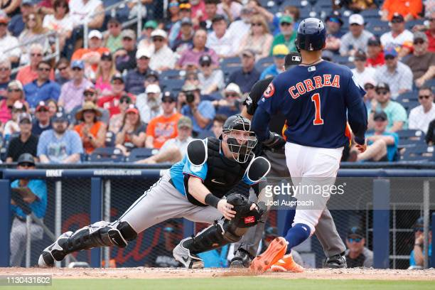 Chad Wallach of the Miami Marlins tags out Carlos Correa of the Houston Astrosfor the final out of the third inning during a spring training game at...