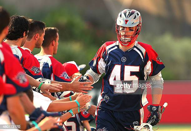 Chad Wiedmaier of Boston Cannons runs on to the field before a game with the Ohio Machine in the second half at Gillette Stadium on July 11 2015 in...