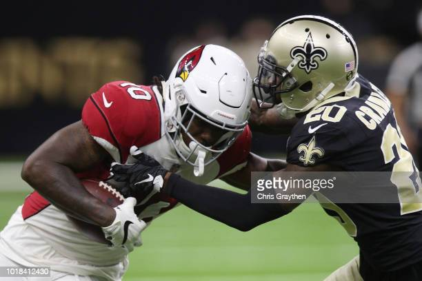 Chad Williams of the Arizona Cardinals is tackled by Ken Crawley of the New Orleans Saints at MercedesBenz Superdome on August 17 2018 in New Orleans...