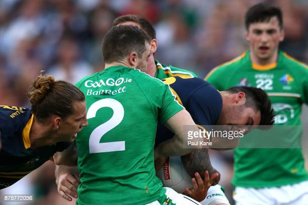 Chad Wingard of Australia gets tackled by Chris Barrett of Ireland during game two of the International Rules Series between Australia and Ireland at...