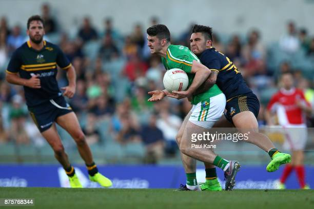 Chad Wingard of Australia tackles Brendan Harrison of Ireland during game two of the International Rules Series between Australia and Ireland at...