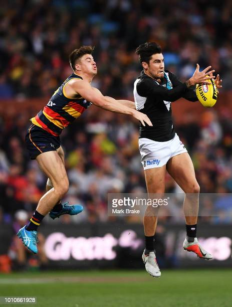 Chad Wingard of Port Adelaide marks in front of Riley Knight of the Adelaide Crows during the round 20 AFL match between the Adelaide Crows and the...