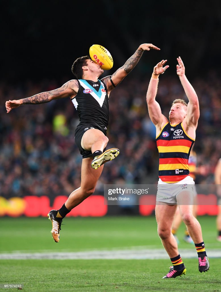 Chad Wingard of Port Adelaide Rory Laird of the Adelaide Crows during the round eight AFL match between the Port Adelaide Power and the Adelaide Crows at Adelaide Oval on May 12, 2018 in Adelaide, Australia.