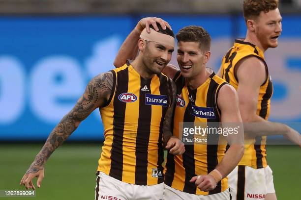 Chad Wingard of the Hawks celebrates a goal with Luke Breust during the round nine AFL match between the Carlton Blues and the Hawthorn Hawks at...