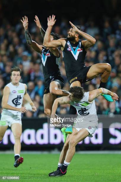 Chad Wingard of the Power and Patrick Ryder of the Power leap for the ball over Lachie Plowman of the Blues during the round five AFL match between...