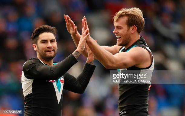 Chad Wingard of the Power celebrates a goal with Jack Watts of the Power during the 2018 AFL round 19 match between the Western Bulldogs and the Port...