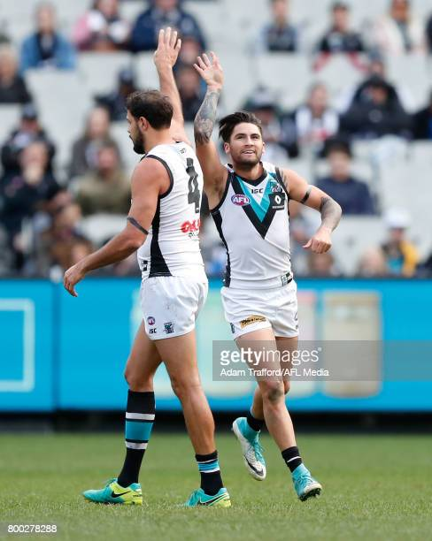 Chad Wingard of the Power celebrates a goal with Paddy Ryder of the Power during the 2017 AFL round 14 match between the Collingwood Magpies and the...