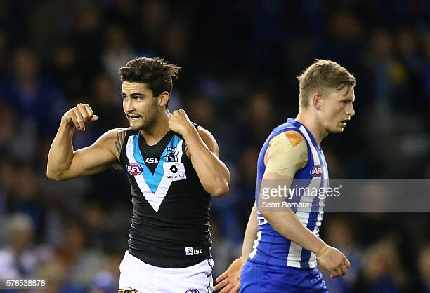 Chad Wingard of the Power celebrates after kicking a goal as Jack Ziebell of the Kangaroos looks on during the round 17 AFL match between the North...