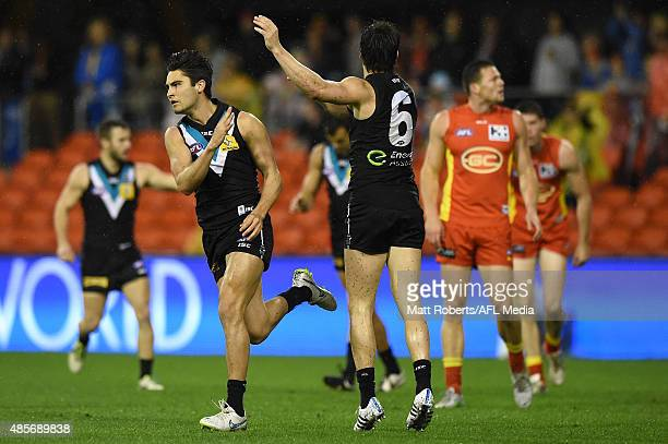 Chad Wingard of the Power celebrates kicking a goal during the round 22 AFL match between the Gold Coast Suns and the Port Adelaide Power at Metricon...