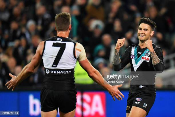 Chad Wingard of the Power celebrates with Brad Ebert of the Power after kicking a goal during the round 23 AFL match between the Port Adelaide Power...