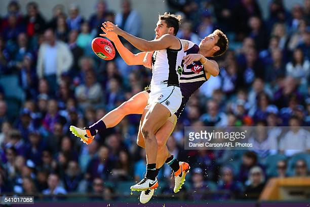 Chad Wingard of the Power contests a mark with Lee Spurr of the Dockers during the 2016 AFL Round 13 match between the Fremantle Dockers and Port...