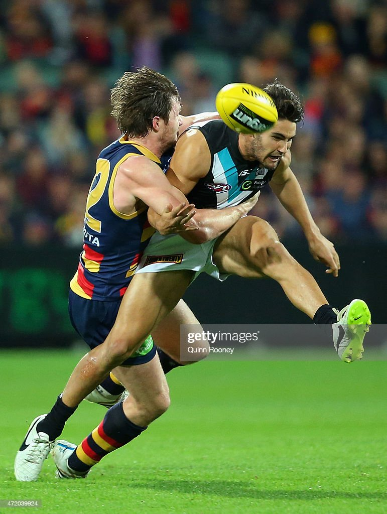 Chad Wingard of the Power kicks whilst being tackled by Patrick Dangerfield of the Crows during the round five AFL match between the Adelaide Crows and the Port Adelaide Power at Adelaide Oval on May 3, 2015 in Adelaide, Australia.