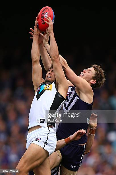 Chad Wingard of the Power marks the ball against Zac Dawson of the Dockers during the round 23 AFL match between the Fremantle Dockers and the Port...