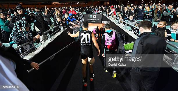 Chad Wingard of the Power walks from the ground at half time after injuring his hamstring during the round 21 AFL match between the Port Adelaide...