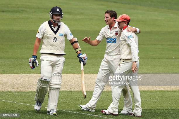 Chadd Sayers and Michael Klinger of the Redbacks celebrate the dismissal of John Holland of the Bushrangers during day one of the Sheffield Shield...
