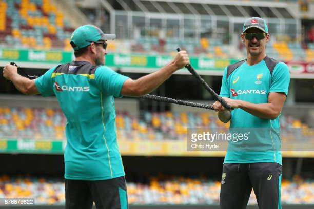 Chadd Sayers and Mitchell Starc stretch during the Australian nets session at The Gabba on November 21 2017 in Brisbane Australia