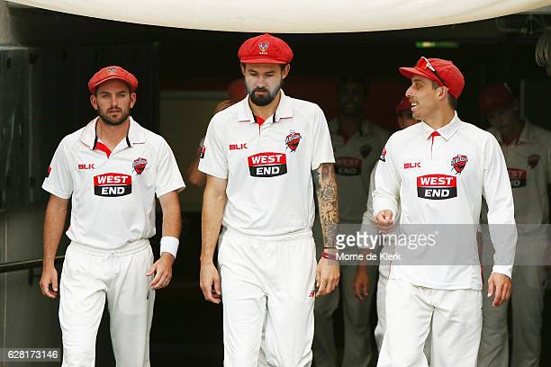 Chadd Sayers Kane Richardson and Jake Lehmann of the SA Redbacks walk out through the players race before the start of play during day three of the...