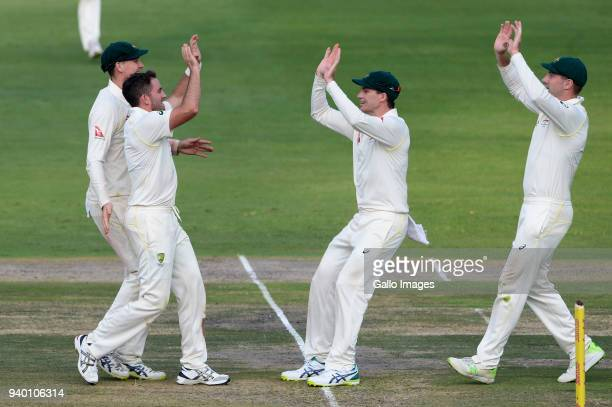 Chadd Sayers of Australia celebrates the wicket of AB de Villiers of the Proteas during day 1 of the 4th Sunfoil Test match between South Africa and...