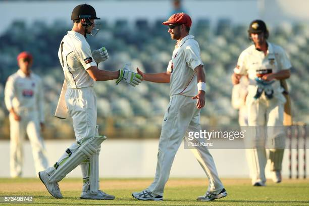 Chadd Sayers of South Australia congratulates Cameron Bancroft of Western Australia on his knock at stumps during day one of the Sheffield Shield...