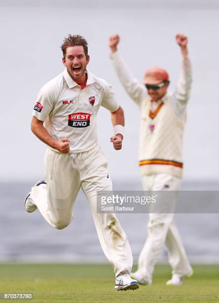 Chadd Sayers of South Australia is congratulated by his teammates after dismissing Scott Boland of Victoria during day two of the Sheffield Shield...
