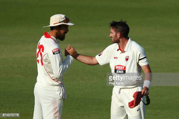 Chadd Sayers of South Australia is congratulated by Tom Cooper after claiming the final wicket in the innings during day three of the Sheffield...