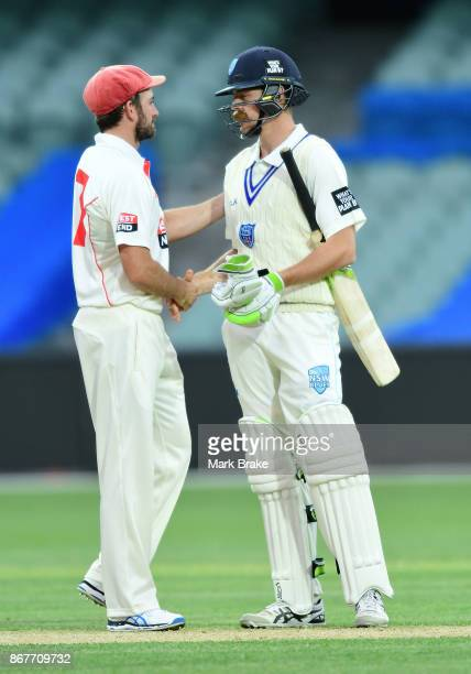 Chadd Sayers of South Australia shakes hands with Daniel Hughes of New South Wales at the end of play during day three of the Sheffield Shield match...