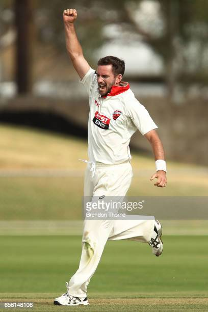 Chadd Sayers of the Redbacks celebrates after claiming the wicket of Jon Holland of the Bushrangers during the Sheffield Shield final between...
