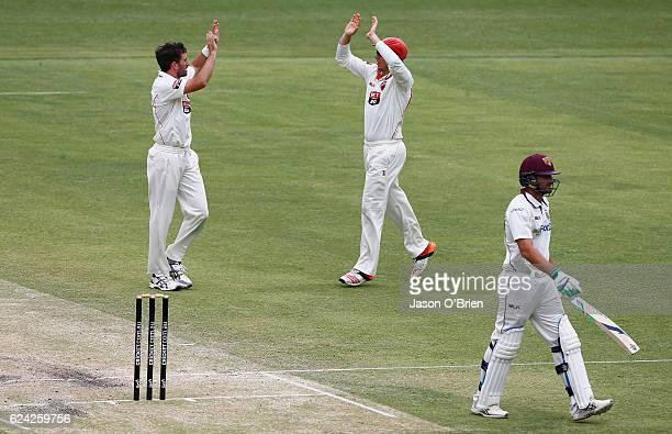 Chadd Sayers of the Redback's celebrates the wicket of Joe Burns during day three of the Sheffield Shield match between Queensland and South...